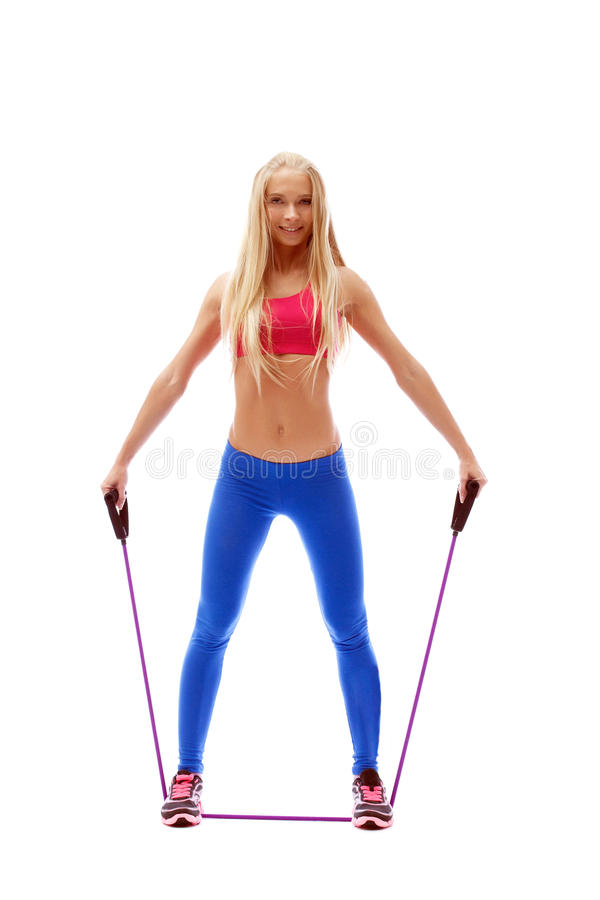 Cute aerobics instructor posing with skipping rope. Isolated on white royalty free stock image