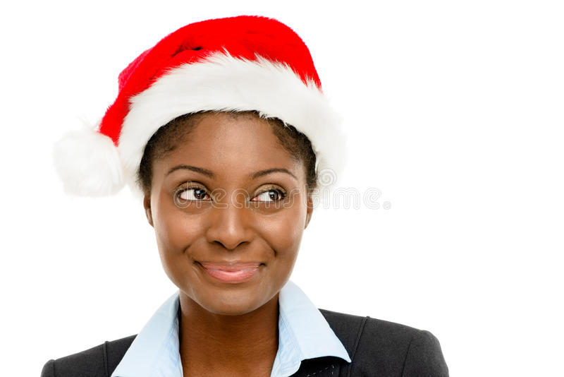 Cute African American businesswomanmaking a wsih wearing Christmas hat isolated on white background stock images