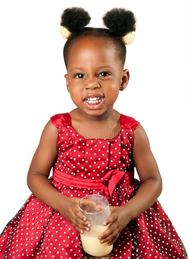 Cute african american girl drinking milk royalty free stock photo