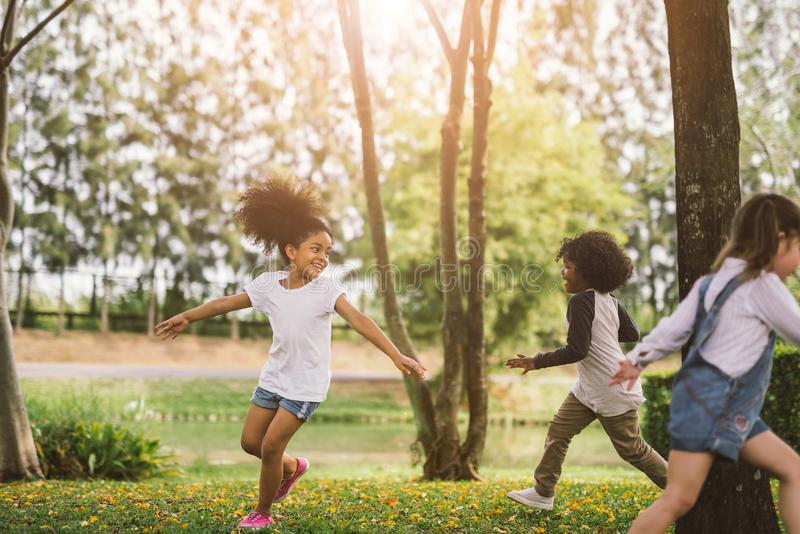 Cute african american little girl playing outdoor royalty free stock photos