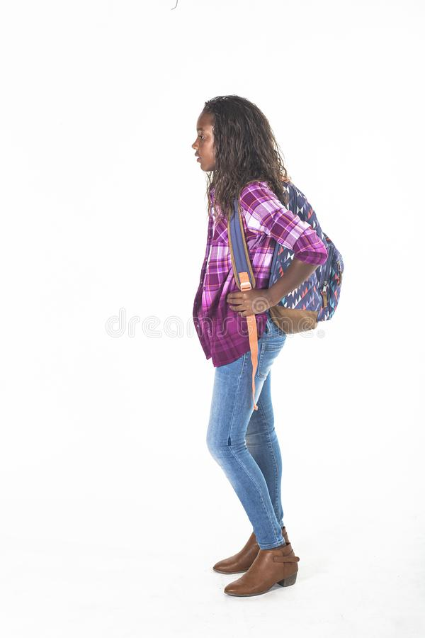 Cute African American school girl with backpack isolated on white royalty free stock photos