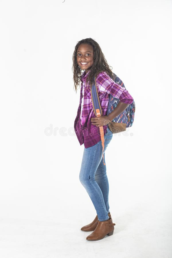 Cute African American school girl with backpack isolated on white stock images