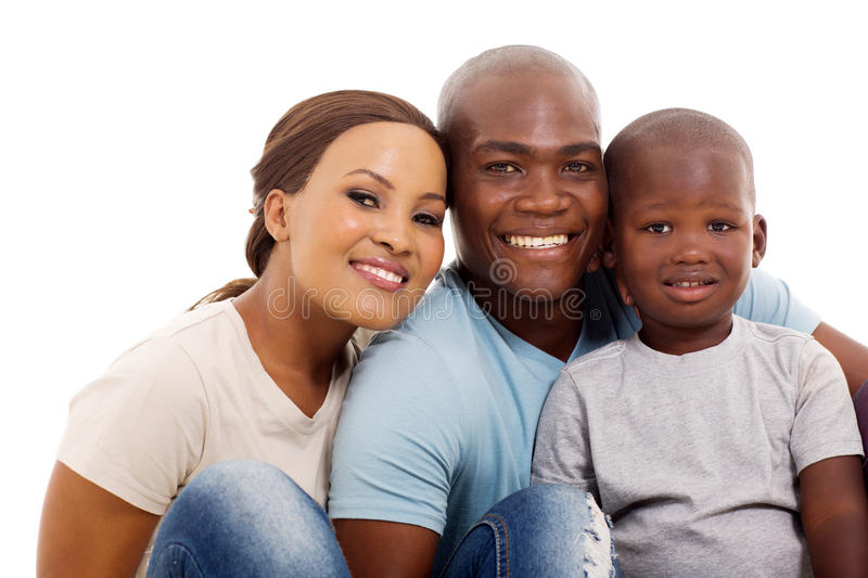 Cute african family. Portrait of cute african family of three sitting on white background royalty free stock photo
