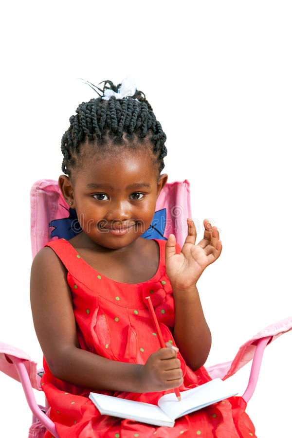 Cute african girl with note book waving hand. Portrait of sweet african girl with note book waving hand.Isolated on white background stock photography