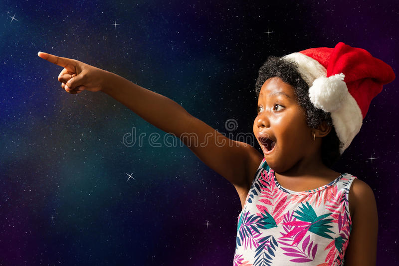 Cute african girl pointing at stars. royalty free stock photos