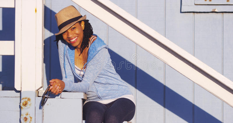 Cute African woman sitting outdoors royalty free stock photos