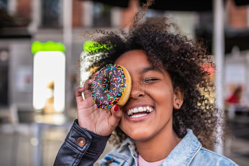 Cute Little Girl Eating a Donuts stock image
