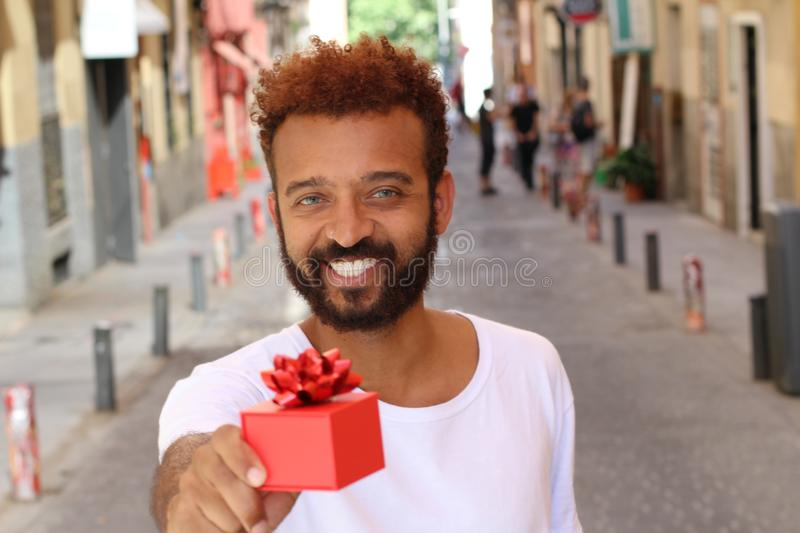 Cute afro man proposing someone outdoors.  royalty free stock photography