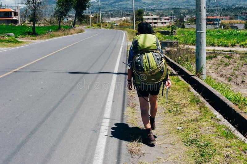Cute American woman hitchhiking in latin america royalty free stock photos