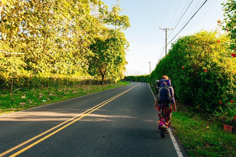 Cute American woman hitchhiking in latin america. Cute latin American woman hitchhiking stock image