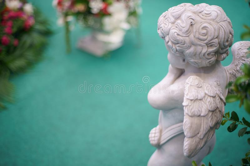 Cute Angel statue in the garden. Beautiful, thais, cupid stock images