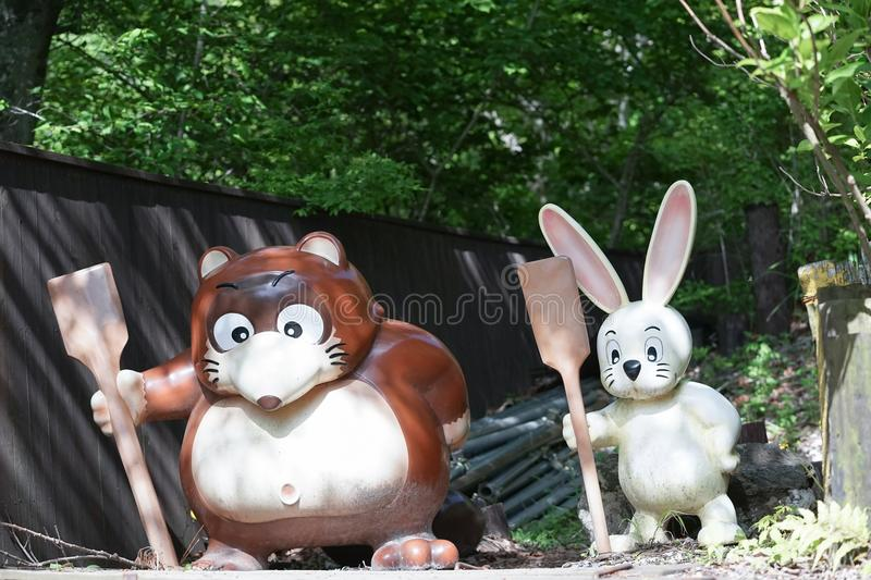 Cute animal statues of a raccoon Japanese Tanuki and a white r. Abbit Usagi at Mt.KACHI KACHI ROPEWAY, Kawaguchiko Tenjoyama park, Japan stock image