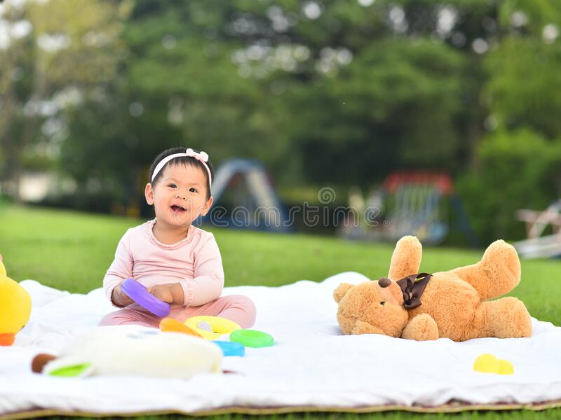Cute Asian Baby Eating Food In Garden Stock Image - Image ...