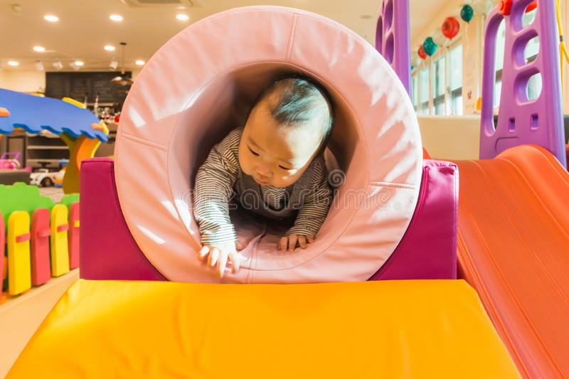 Cute Asian baby playing on the indoor playground. Cute Asian Korean baby playing on the indoor playground stock photos