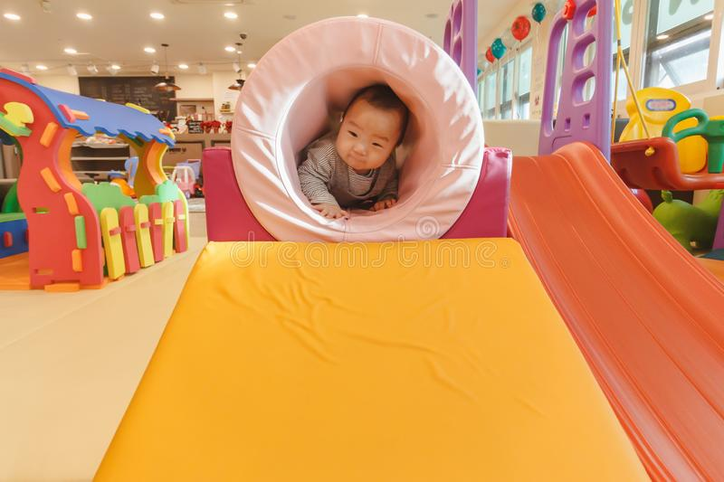 Cute Asian baby playing on the indoor playground. Cute Asian Korean baby playing on the indoor playground royalty free stock photos