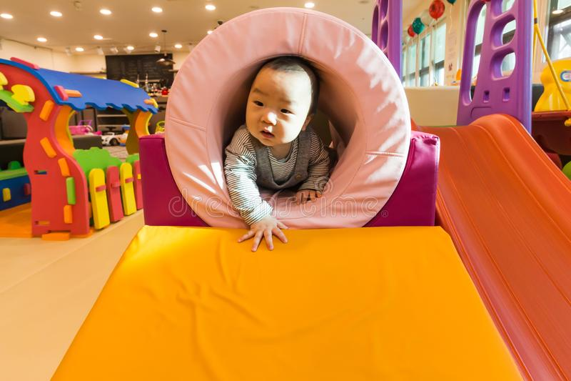 Cute Asian baby playing on the indoor playground. Cute Asian Korean baby playing on the indoor playground royalty free stock photography
