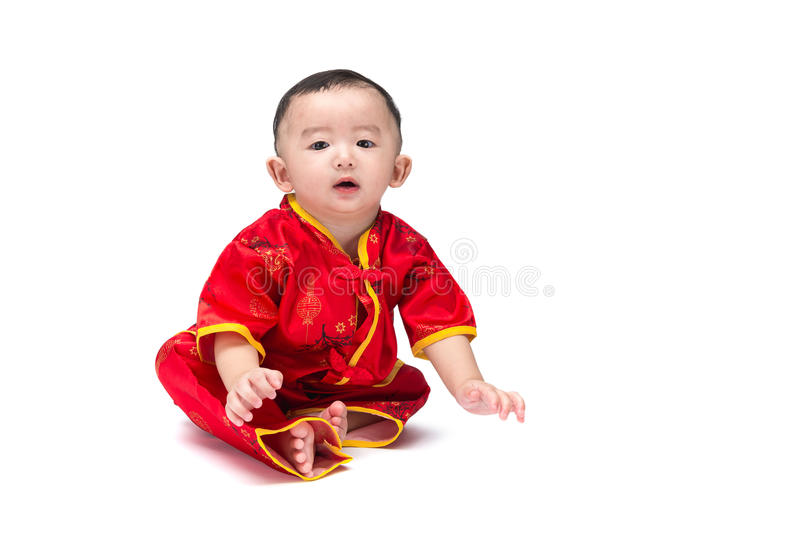 Cute Asian baby in traditional Chinese suit Isolated on white ba stock photography