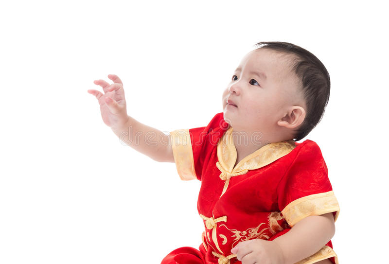 Cute Asian baby in traditional Chinese suit Isolated on white ba royalty free stock image
