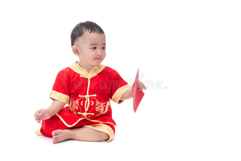 Cute Asian baby in traditional Chinese suit with red pocket, Iso stock photos