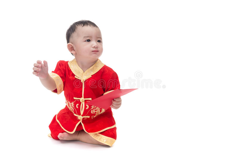 Cute Asian baby in traditional Chinese suit with red pocket, Iso stock images