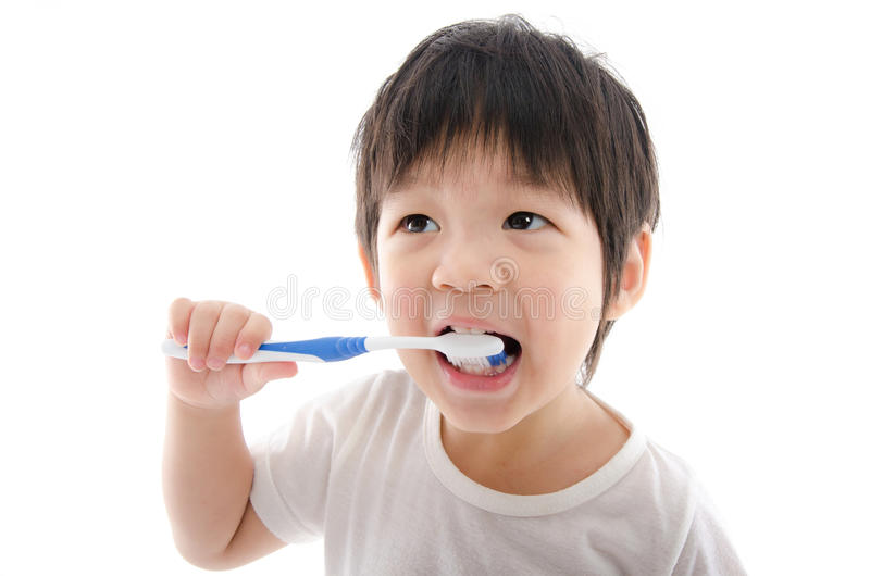 Cute asian bay brushing teeth on white background stock photos