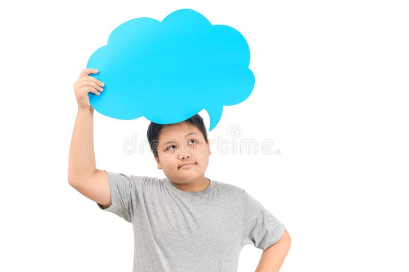 Cute asian boy holding empty blue speech bubble isolated stock image