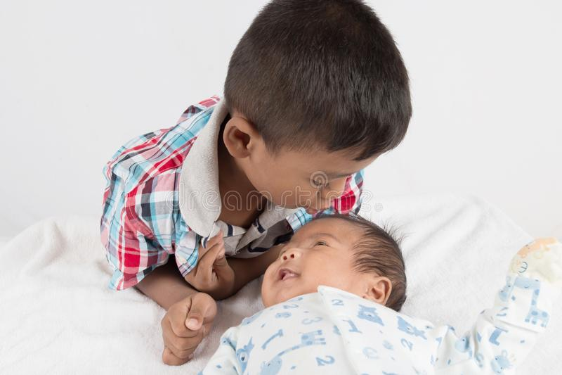Cute asian boy kiss baby stock images