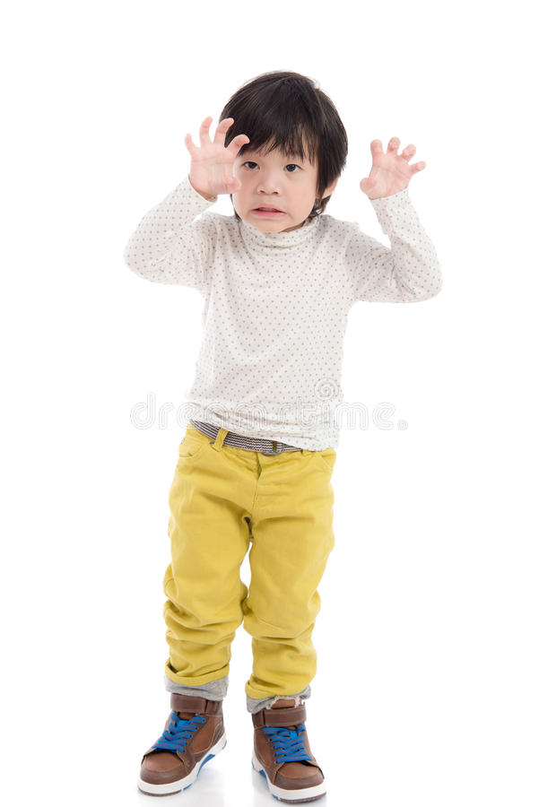 Cute asian boy reaching hands. On white background isolated royalty free stock photos