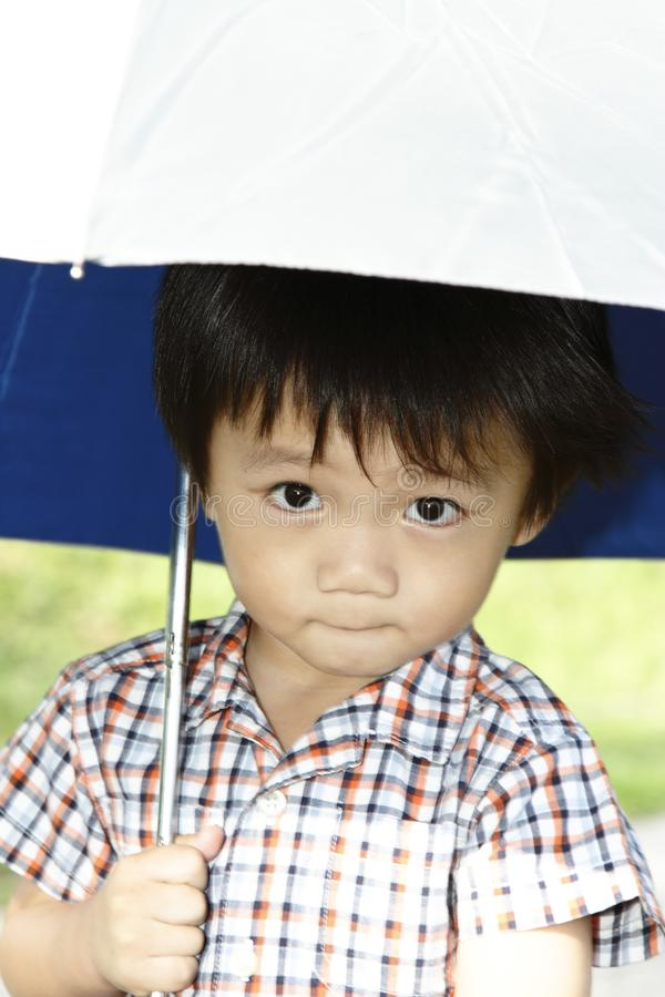 Cute Asian boy with umbrella