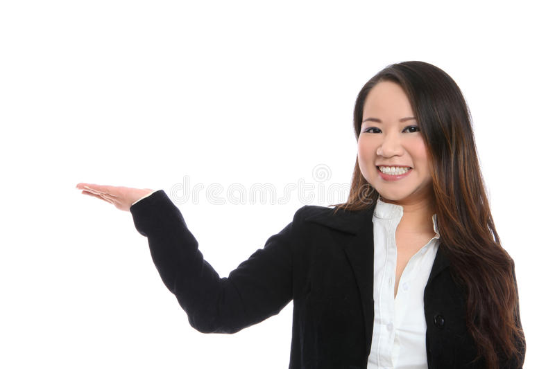Cute Asian Business Woman. A young cute asian business woman making a presentation royalty free stock photo