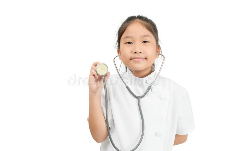 Cute asian child in doctor coat holding stethoscope isolated stock image