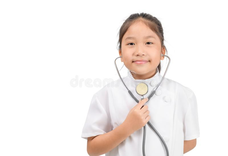 Cute asian child in doctor coat holding stethoscope isolated stock photos