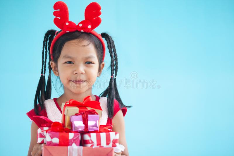 Cute asian child girl holding beautiful gift in hand stock photos