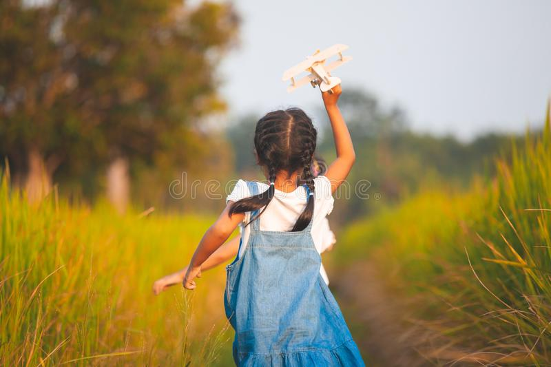 Cute asian child girl running and playing with toy airplane stock images