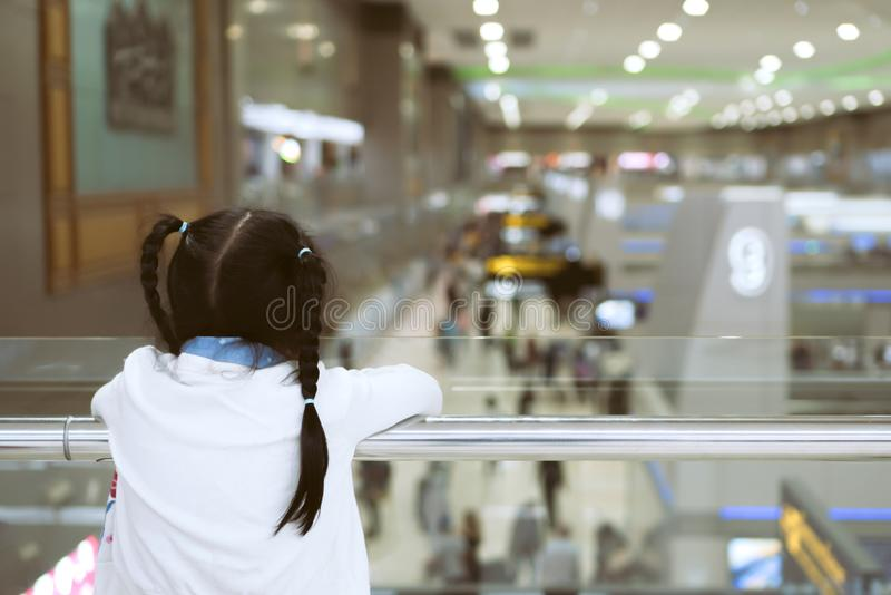 Asian child girl waiting for boarding in the airport royalty free stock photos
