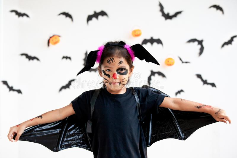 Asian child girl wearing halloween costumes and makeup having fun on Halloween celebration stock photos