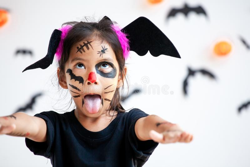 Asian child girl wearing halloween costumes and makeup having fun on Halloween celebration royalty free stock photo
