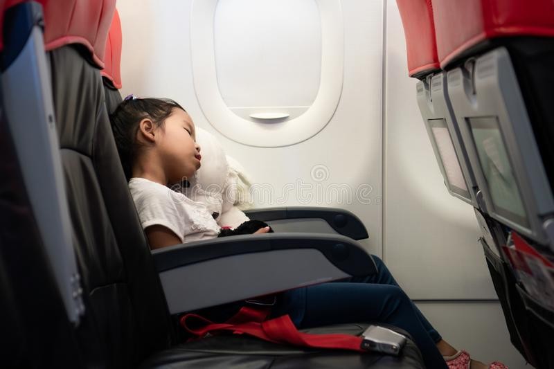 Cute asian child girls traveling by an airplane stock photo