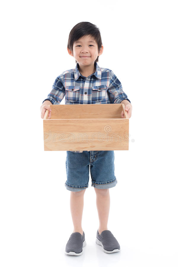 Cute Asian child holding empty wooden box royalty free stock photos