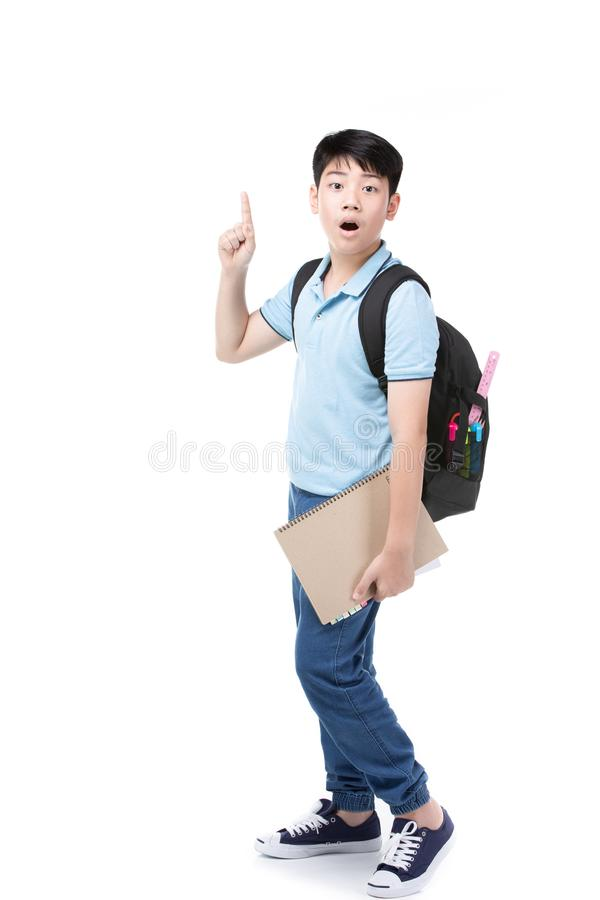 Cute asian child with school stationery on white background royalty free stock images