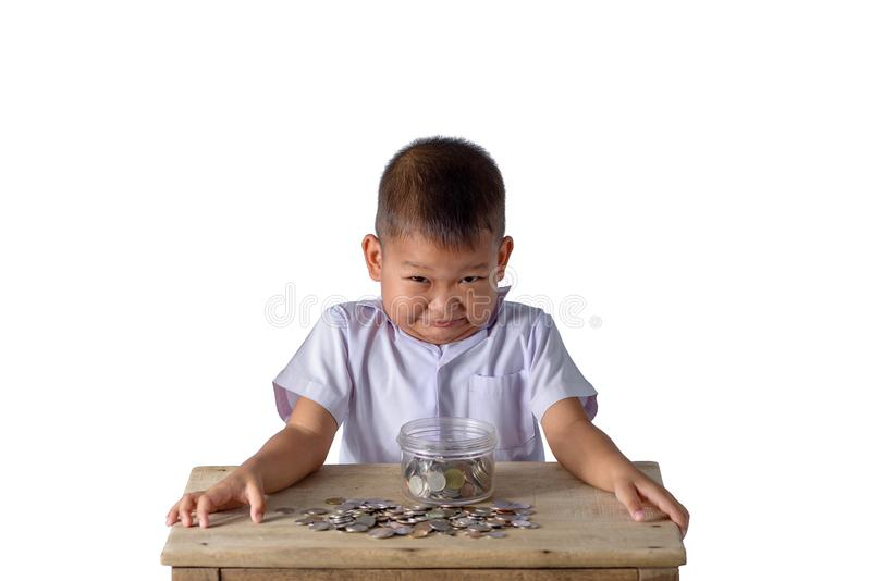 Cute asian country boy have fun with coins in Glass bowl isolate royalty free stock photos
