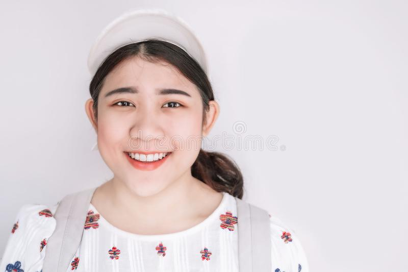 Cute Asian Fat Teen Girl Young smiling on white space for text royalty free stock photo