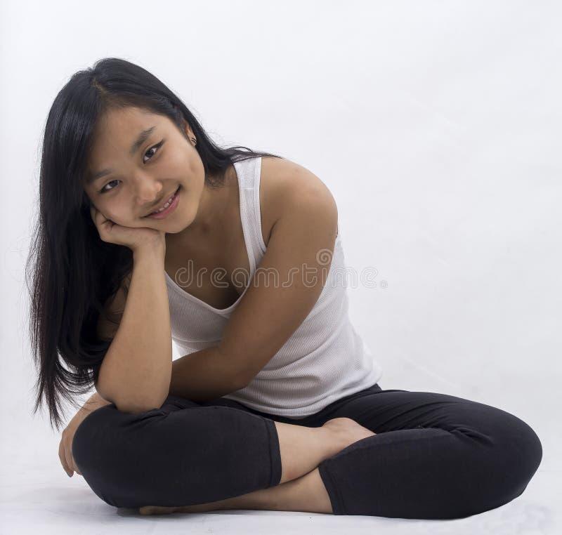 Cute asian girl on background meditating stock photo