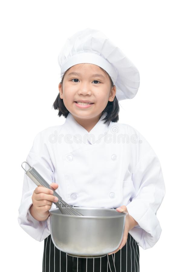 Cute asian girl chef holding whisk with bowl a stock image