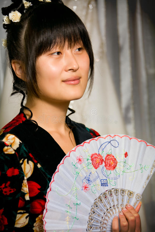 Cute asian girl with fan royalty free stock image