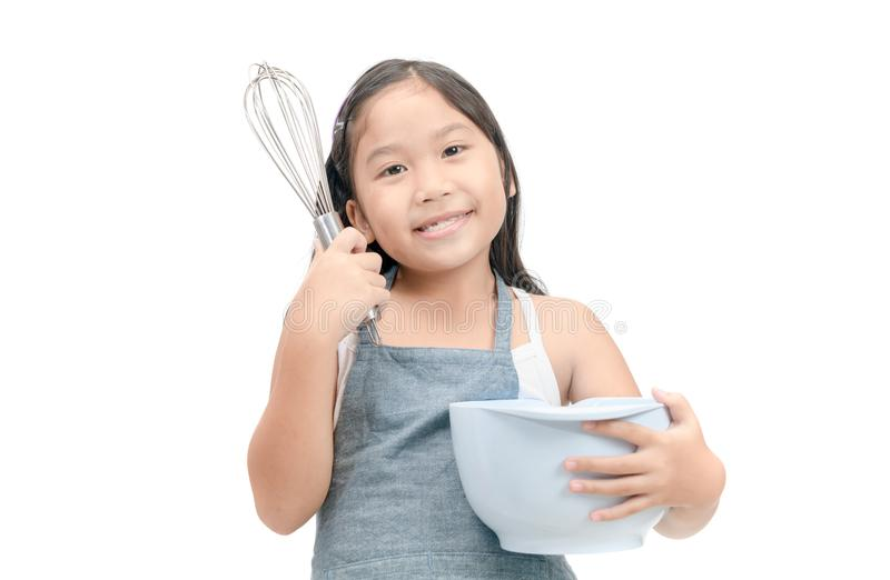 Cute asian girl holding cooking utensils. Isolated on white background stock photos