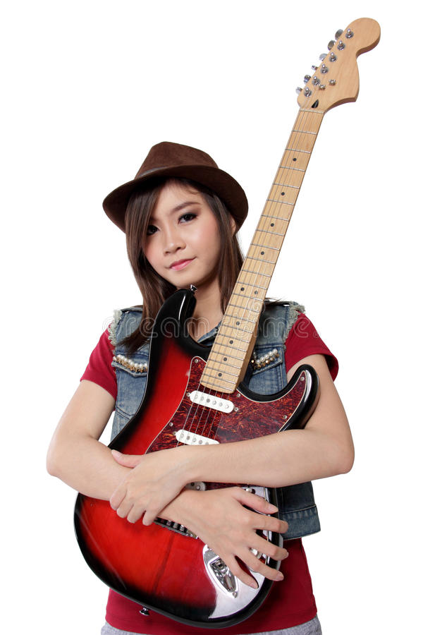 Cute Asian girl hugging her guitar, on white background royalty free stock images