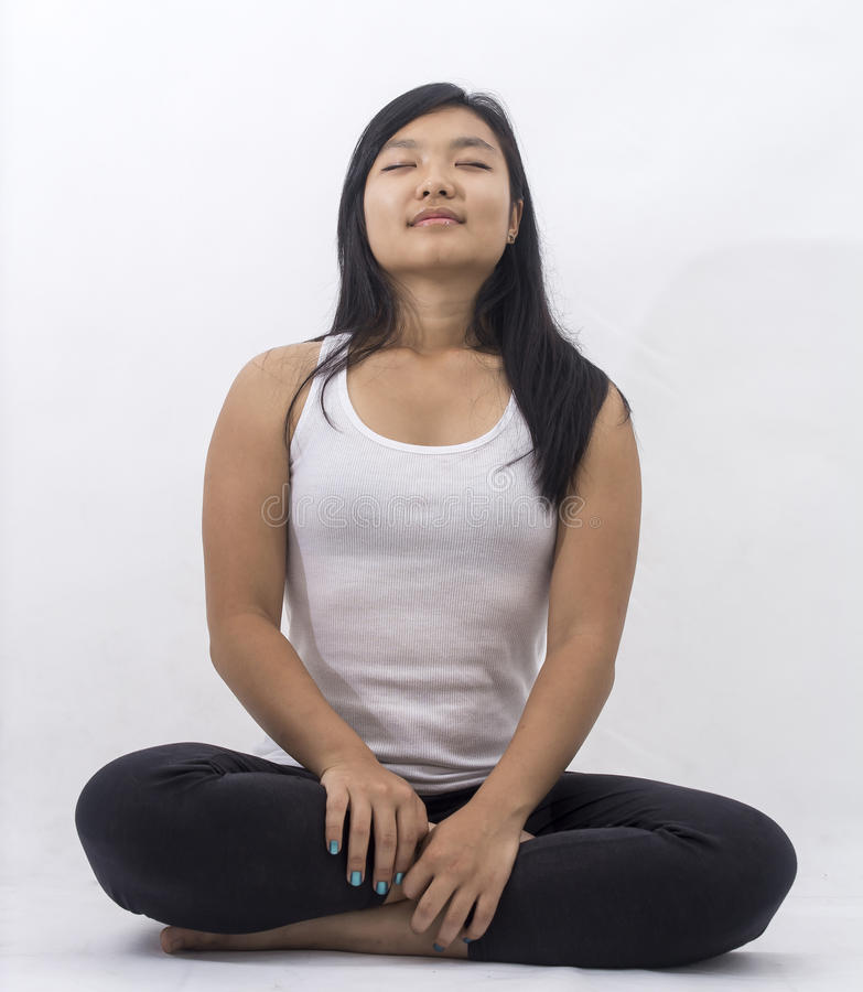 Cute asian girl on isolated background on meditation royalty free stock photo