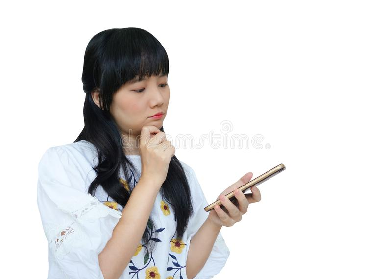 Cute Asian Girl Thinking while Using Mobile Phone royalty free stock photo