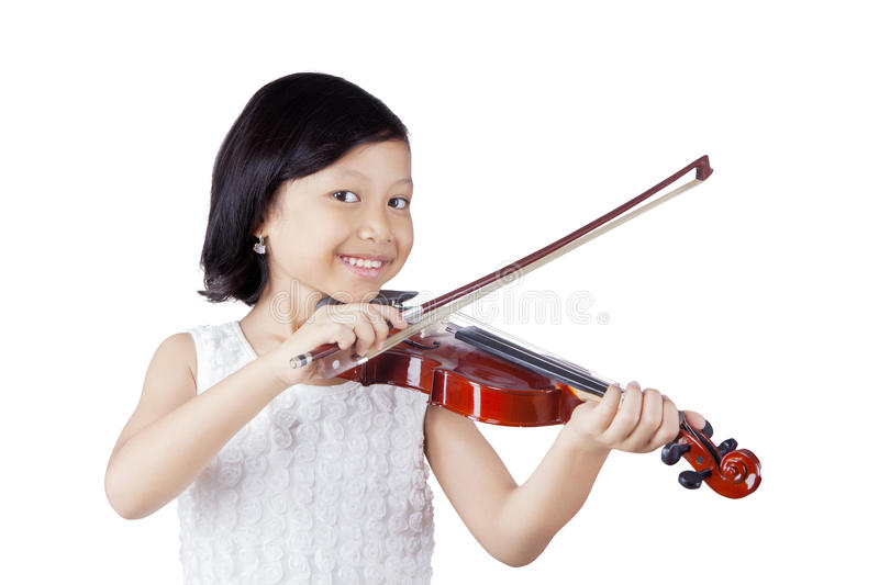 Cute Asian girl with violin royalty free stock photos